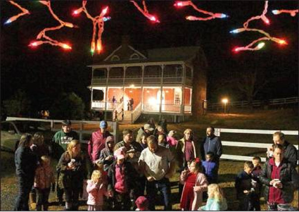 Local residents wait for their turn to get on the trolley for a ride to view the holiday lights display at Glen Maury Park. (Stephanie Mikels Blevins photo)