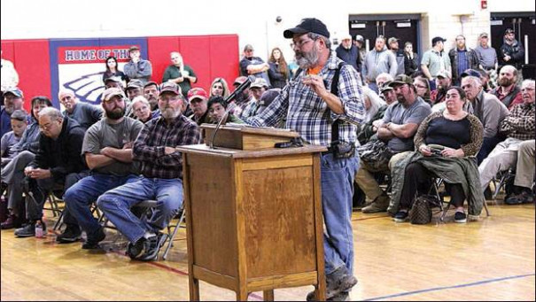 "TIM GOODBAR speaks in favor of having the Board of Supervisors adopt a resolution designating Rockbridge County as a ""sanctuary"" for Second Amendment rights before a crowd of hundreds at Maury River Middle School. (Ed Smith photo)"