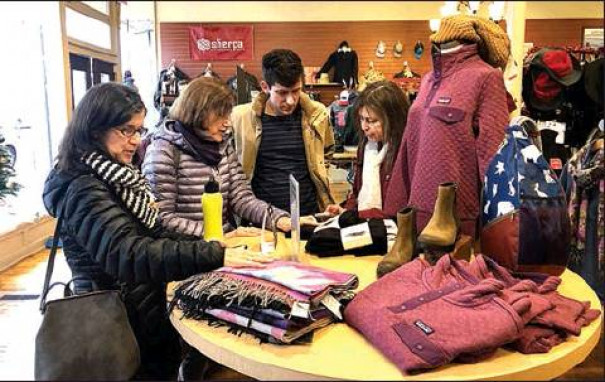 AT WALKABOUT OUTFITTERS on Black Friday, Sara Cunningham (at right) of Lexington shops with her sisters (from left) Barbara Wedig from New York and Carol Miller from Washington, D.C., as well as her nephew Dan Wedig. (Claudia Schwab photo)