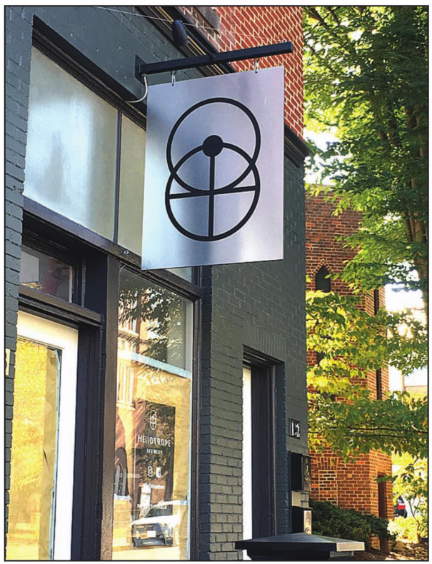 THE LONG-AWAITED brewery Heliotrope opened in December. With assistance from Main Street Lexington, the business installed a new sign that displays its logo.