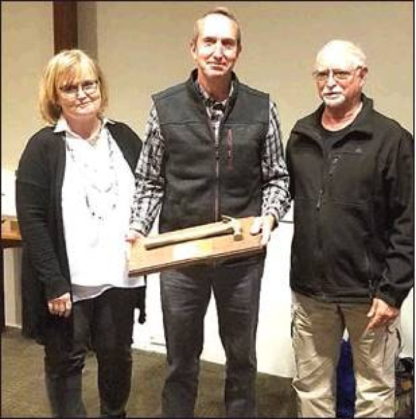 RUSS ORRISON (center) is presented with the Golden Hammer Award by Lynne Johnson, Rockbridge Area Habitat executive director; and Stan Ponce, chair.