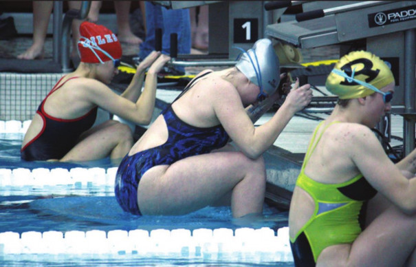 PM SENIOR Breanne Moore (center) gets ready to start the 100-yard backstroke, in which she placed seventh in 1:13.84 to advance to the state meet. (Dylan May photo)