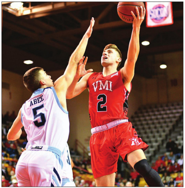VMI SENIOR guard Garrett Gilkeson goes up for a shot while The Citadel's Fletcher Abee tries to get a hand in his face. Gilkeson scored 16 points and had eight rebounds, four assists two steals and block. (VMI photo by Chuck Steenburgh)