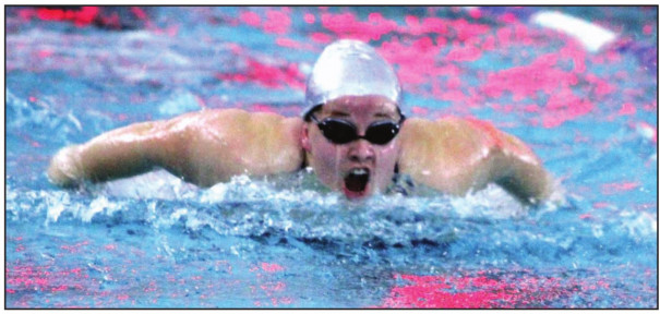PM SENIOR Breanne Moore competes in the girls' 200-yard individual medley, in which she placed sixth. Moore and other seniors were honored at the meet. (Stephanie Mikels Blevins photo)