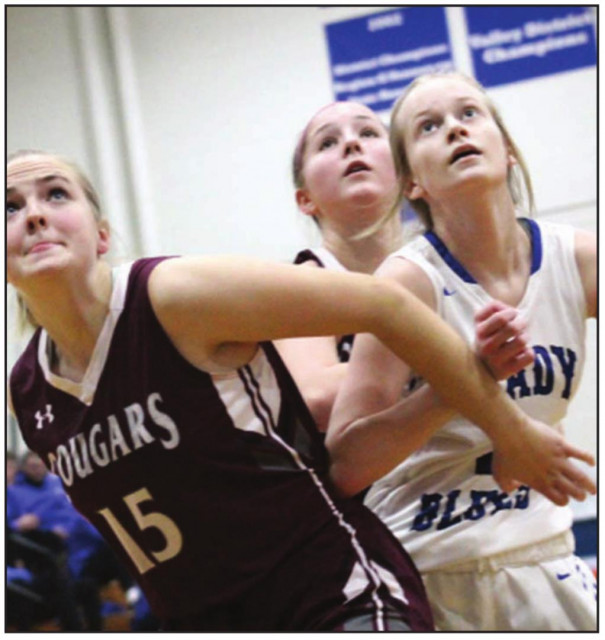 STUARTS DRAFT'S Megan Fretwell (15) and PM sophomore guard Amber Grow battle for position during the Blues' 53-36 loss. (Ronnie Coffey photo)