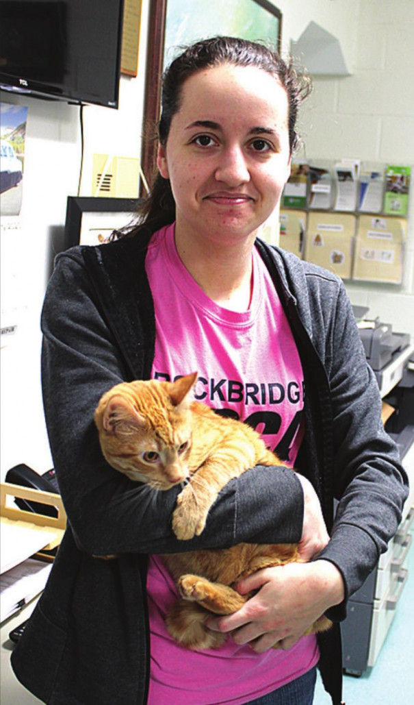 DANNY, held by kennel supervisor Katelyn Smith, is one of the cats available for adoption at the Rockbridge Area SPCA.