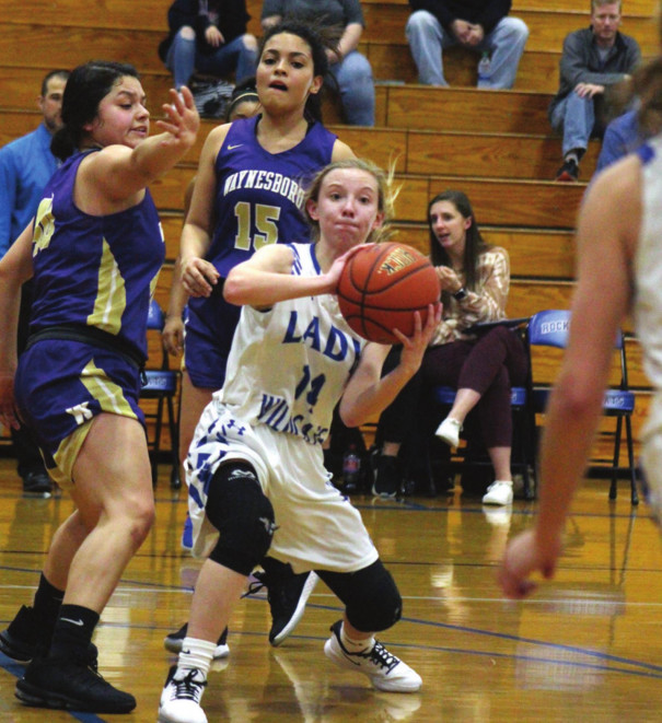 RC SENIOR guard Emily Galford looks for an open teammate while Waynesboro's Mariela Ruiz guards her during the Wildcats' home win last Tuesday. Galford scored 16 points, making three 3-pointers, and had three steals. (Stephanie Mikels Blevins photo)