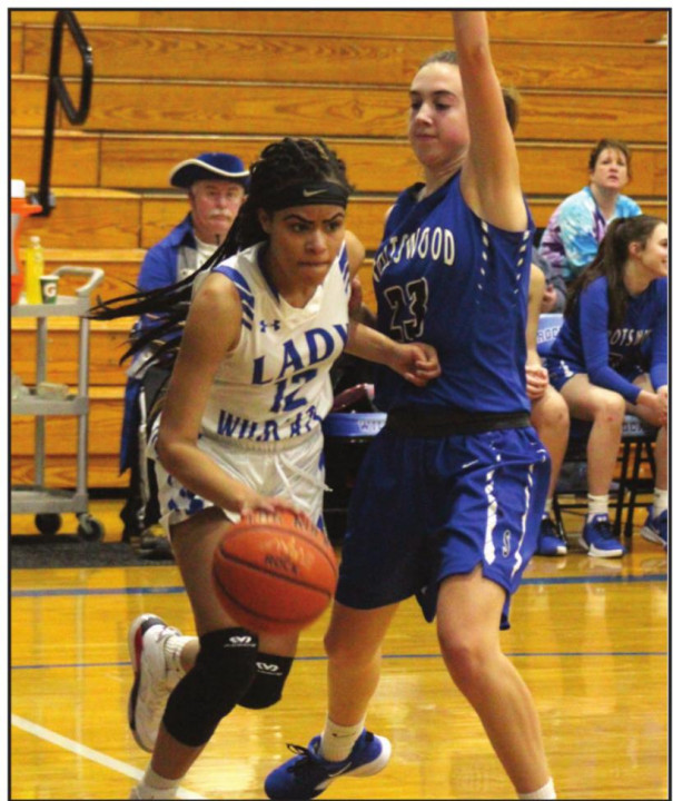 WILDCAT SOPHOMORE forward Aiyana Cooper dribbles near the basket while Spotswood's Abigail Branner guards her. Cooper scored four points and made two steals. (Stephanie Mikels Blevins photo)
