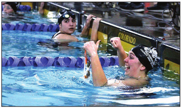 WILDCAT JUNIOR Hope Huger celebrates after finishing sixth in the girls' 200-yard freestyle. (Stephanie Mikels Blevins photo)