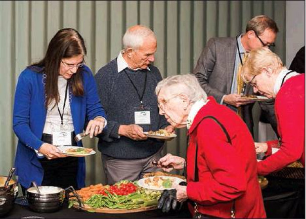 CFRBA DONOR Patty Thomas, Paul Robblee and JoAnne Robblee enjoy food provided by CHEFS Catering during the annual reception for the Community Foundation for Rockbridge, Bath and Alleghany. (Brandi Wimer photo)