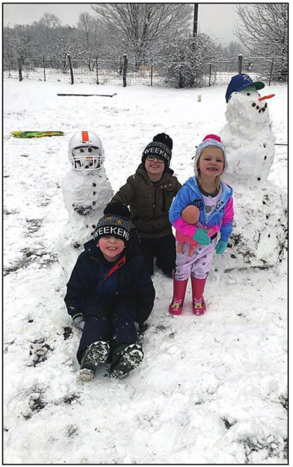 The snowmen built by the Knight family last Tuesday, Jan. 7, took on a decidedly sports look. Pictured in Buena Vista are builders Colton, Landon and Olivia. The photo was one of many posted on The News- Gazette's Facebook page following the first snow of the winter.