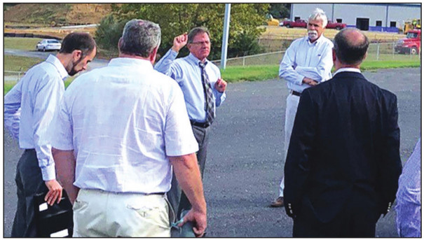 JAY SCUDDER speaks to local government officials and members of the Virginia Economic Development Partnership during a tour of Buena Vista's industrial park last year.