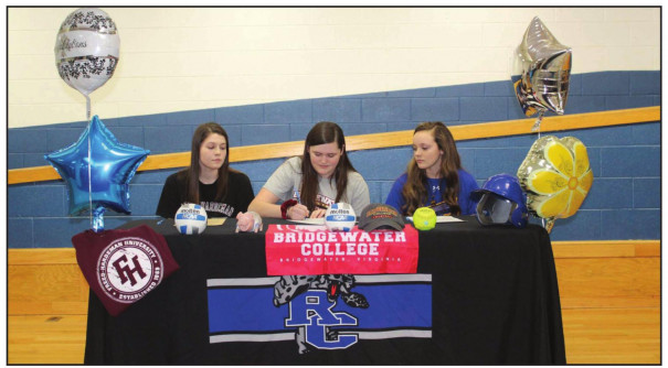 RC'S GRACEON Armstrong signs her letter of intent to play volleyball at Bridgewater College while fellow seniors Emma Lawson (left) and Savannah McDaniel watch. Lawson signed to play volleyball at Freed-Hardeman University, and Mc- Daniel signed to play softball at Patrick Henry Community College. (Jonathan Schwab photo)