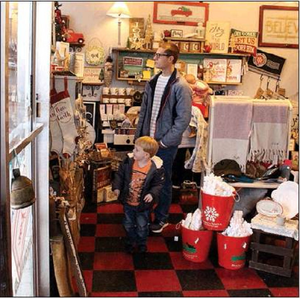 BRAD AUSTIN and his son Oliver shop at Vinyl Cuts in Buena Vista on Small Business Saturday. (Stephanie Mikels Blevins photo)