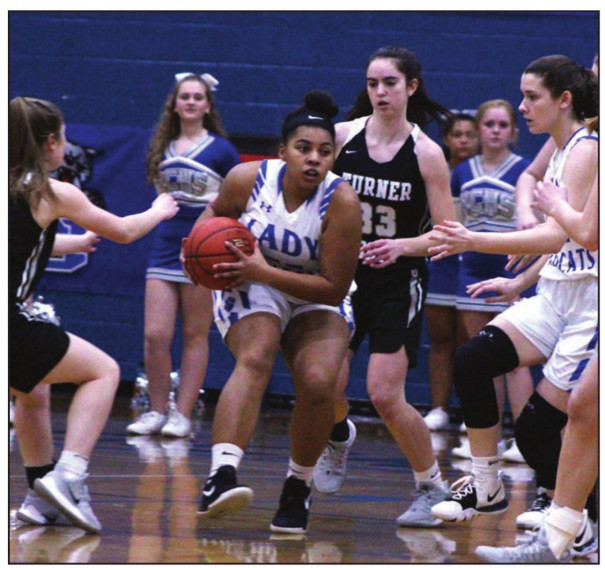 ABOVE, Surrounded by Knights, RC senior forward Phynely Stores holds onto the ball as teammate Emily Mahood (second from right) moves in to help. AT RIGHT, Wildcat senior forward Graceon Armstrong and TA's Becca Shiflet start the game by going for a jump ball. (Stephanie Mikels Blevins photos)
