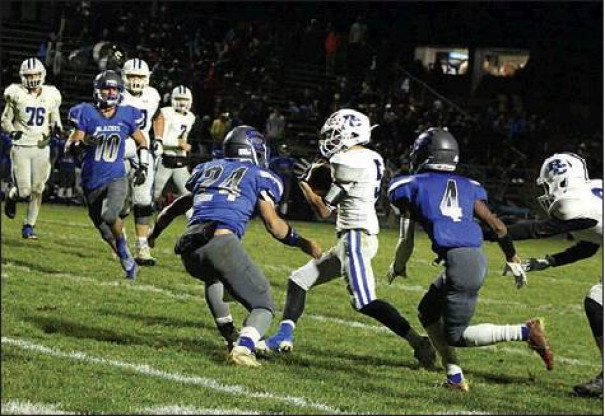 WILDCAT WIDE receiver Seamus Looney runs with the ball after making a catch while Spotswood's Ethan Barnhart (24) and Quentin Hayes (4) approach. Looney caught two passes for 17 yards. (Stephanie Mikels Blevins photo)
