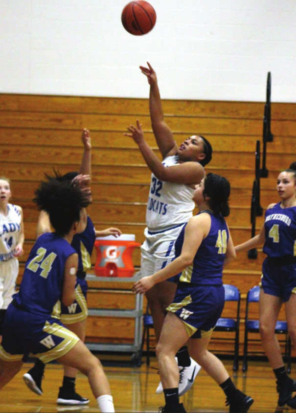 WILDCAT SENIOR forward Phynely Stores puts up a shot while surrounded by Waynesboro defenders. Stores grabbed 10 rebounds and scored four points. (Stephanie Mikels Blevins photo)