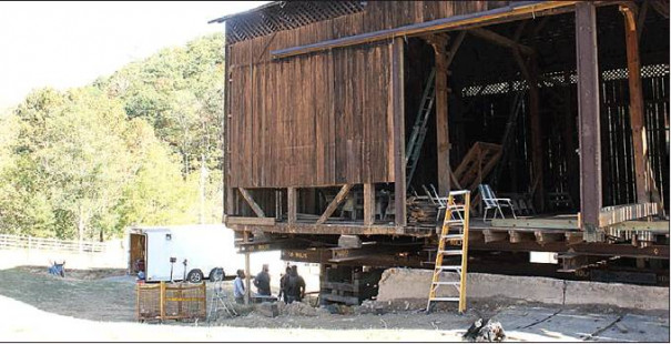 THE HISTORIC BARN on Walkers Creek Road can be seen from behind as it was suspended off the ground earlier this fall.