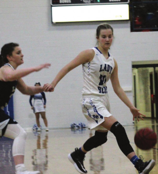 PM SOPHOMORE guard Maddie Henson dribbles down the court as a Covington player defends her. (Ronnie Coffey photo)