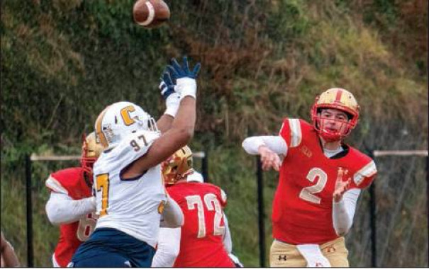 VMI JUNIOR quarterback Reece Udinski throws a pass over the hands of Chattanooga's Tavi McLean. Udinski completed 20-of-36 passes with two interceptions for 214 yards and two touchdowns. (VMI photo by Randall Wolf)