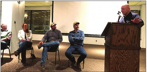 TOM STANLEY, agricultural Extension agent for Rockbridge County, introduces the panel of local farmers at last month's forum on water quality issues. Panelists (from right to left) Jon McDonald, Beau Leech, Margaret Ann Smith and Allen Strecker listen. (Colin Whitmore photo)