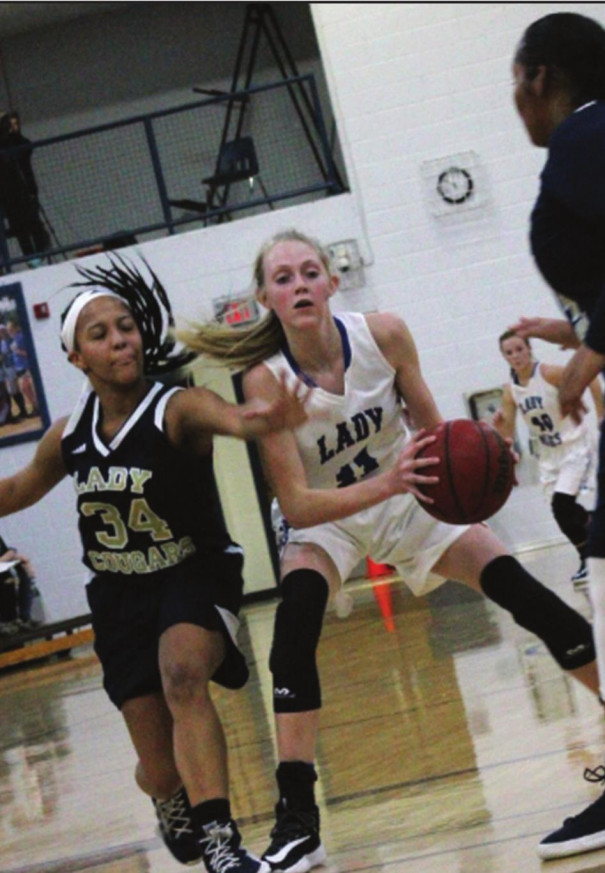 FIGHTING BLUE freshman guard Anna Claytor holds onto the ball while Covington's Amiah Hunter pressures her. Claytor scored 11 points. (Ronnie Coffey photo)