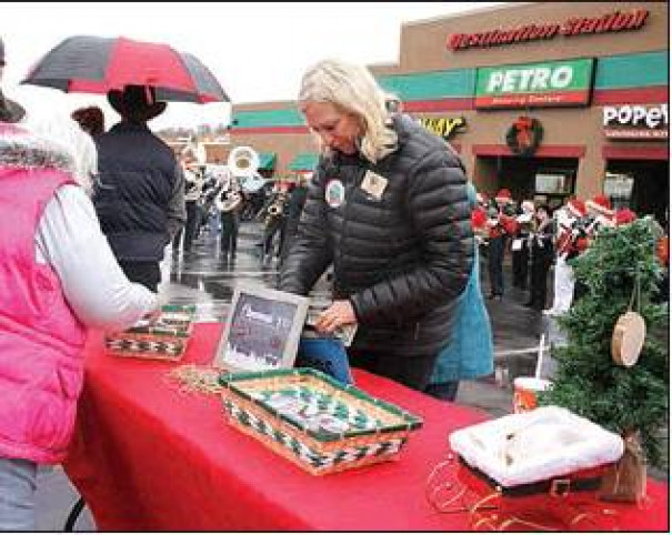 Mo McElroy with the nonprofit Choose Outdoors sells ornaments to raise funds to send the winner of the U.S. Capitol Christmas Tree essay contest to the tree lighting.