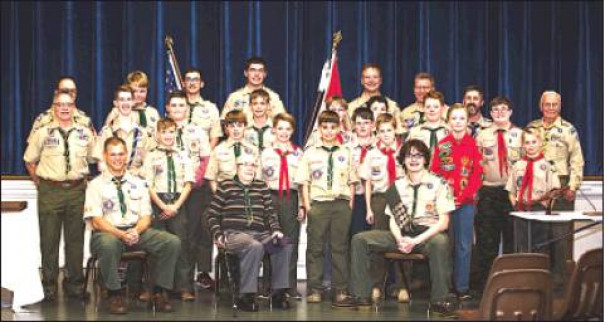 WORLD WAR II veteran Carl Planck (center front) is pictured with Troop 5, where he was inducted as an honorary Troop 5 member. Troop 5 is lead by Senior Patrol Leader Scottie Martin and Scoutmaster Jamie Maxwell. (photo by Tamara Hattersley)