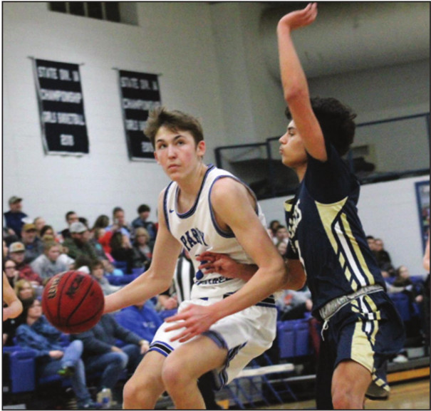 PM SOPHOMORE forward Spencer Hamilton takes the ball toward the basket while a Covington player guards him. Hamilton scored eight points and pulled down seven rebounds. (Ronnie Coffey photo)