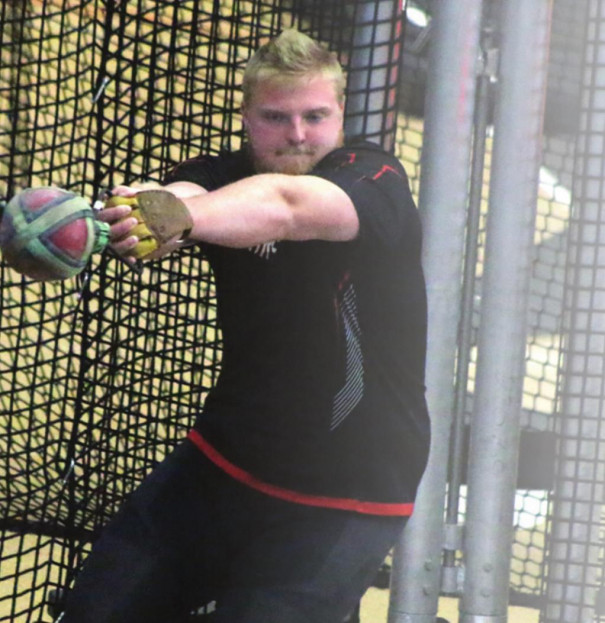 JOSH FISCHER spins before releasing the weight throw. Fischer placed fourth with a personalrecord mark. (Stephanie Mikels Blevins photo)