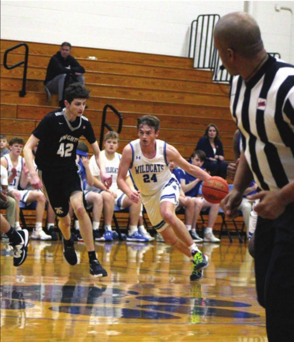 RC JUNIOR guard Aaron Plogger dribbles down the court as Turner Ashby's Garret Spruhan defends him. Plogger scored five points. (Stephanie Mikels Blevins photo)