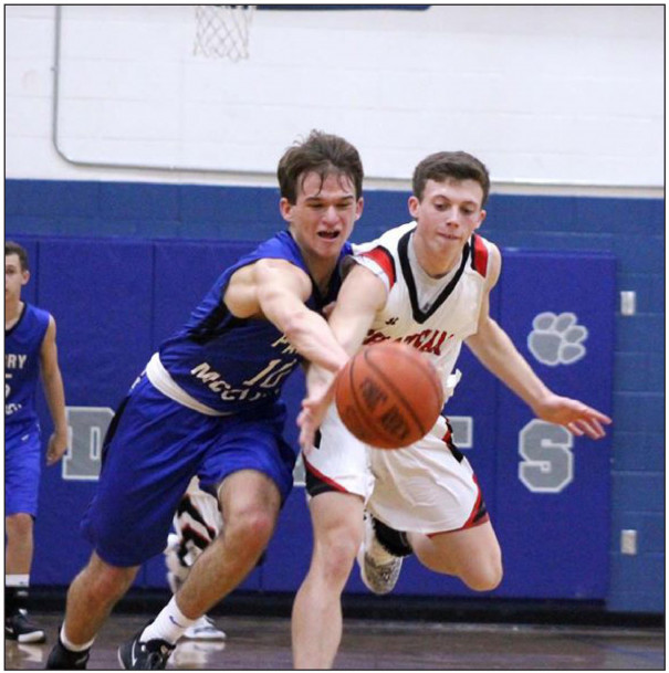 PM JUNIOR guard Talen Roberts goes for one of his three steals during the Blues' 59-32 win over Chatham. Roberts also scored six points. (Stephanie Mikels Blevins photo)