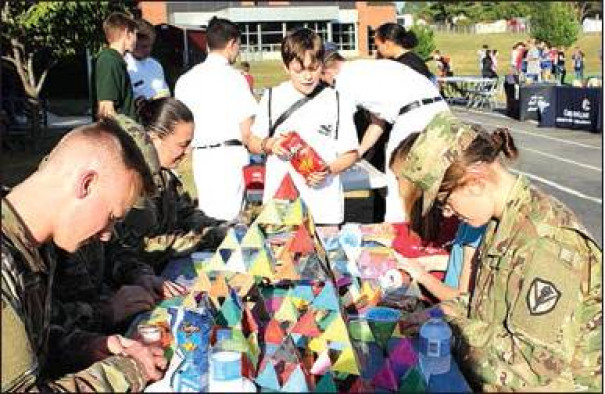 VMI CADETS build paper towers with MRMS students during the open house for the school's Youth Achieving Success program. (Katie Doar photo)