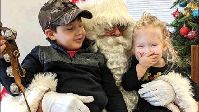 Chase Camden, 5, and sister Montana, 2, enjoy visiting with Santa during the Breakfast With Santa at the Fairfield Rescue Squad. (Mary Woodson photo)